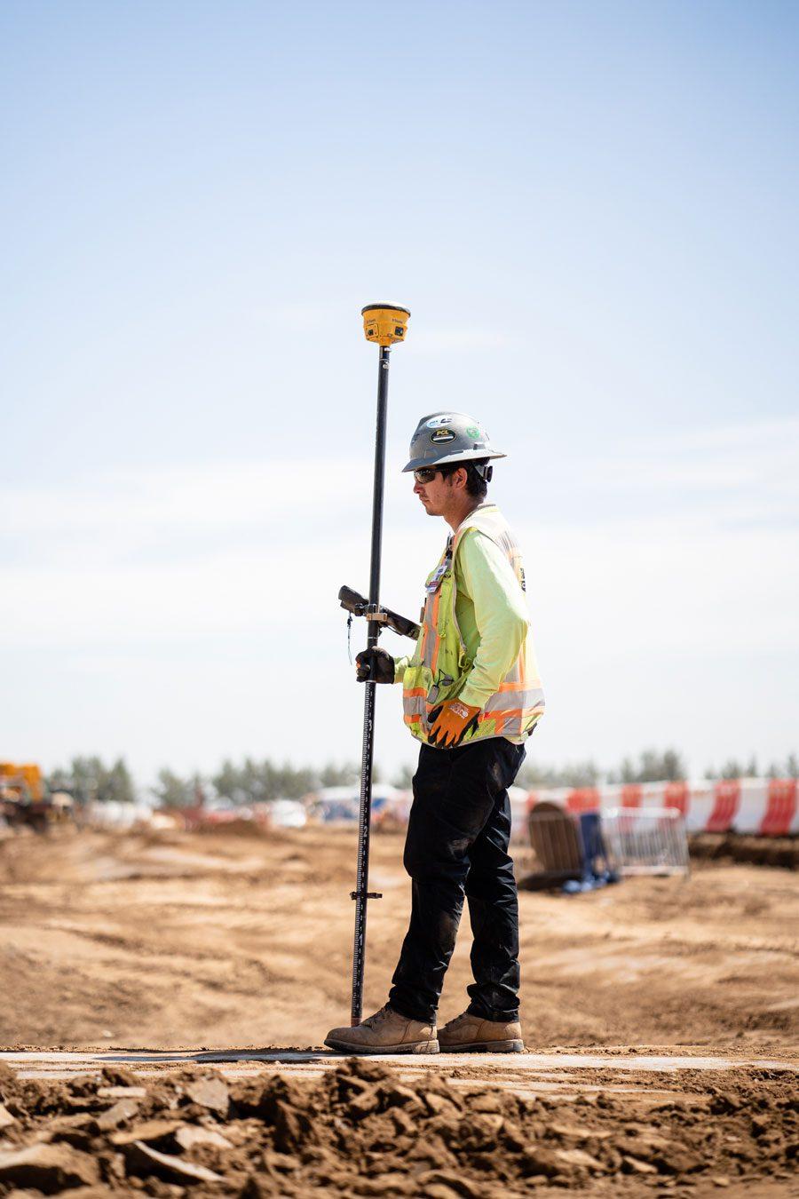 Blount Employee Holding GPS Survey Equipment