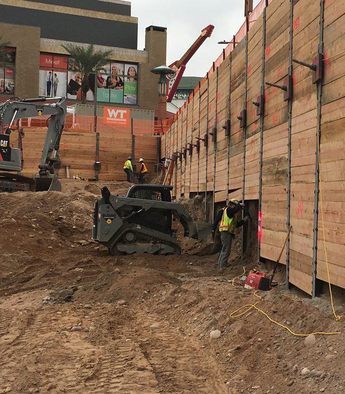 Blount's Mini Excavator Working on Beam and Lagging