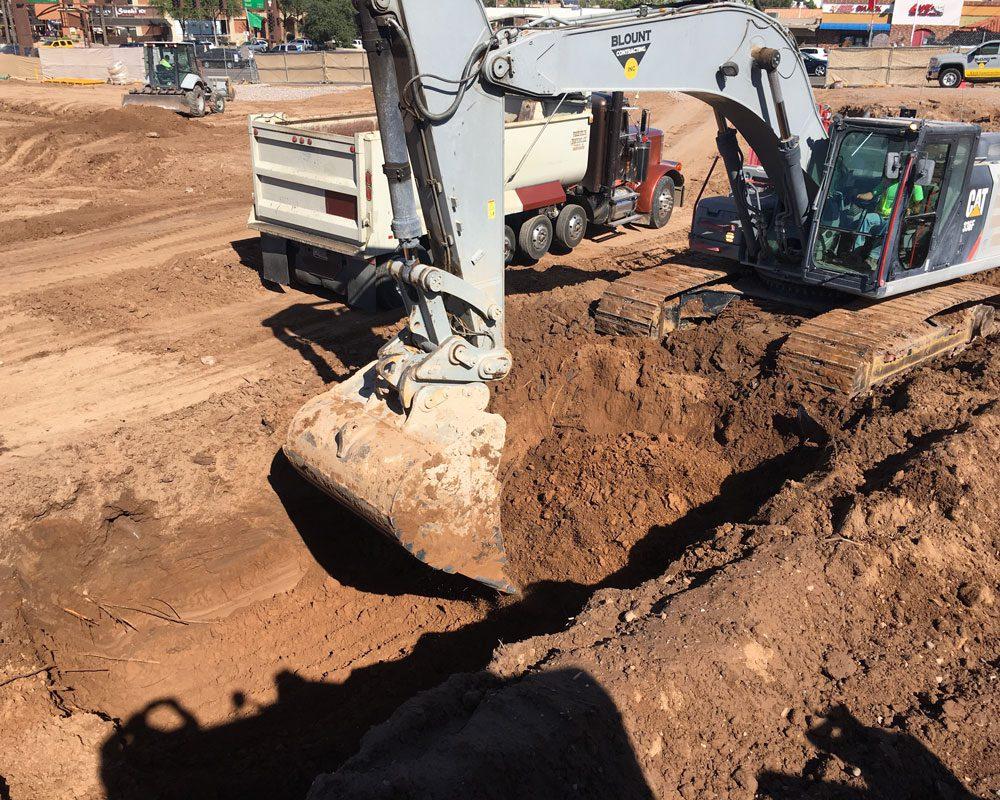 CAT Bulldozer Moving Dirt at Job Site