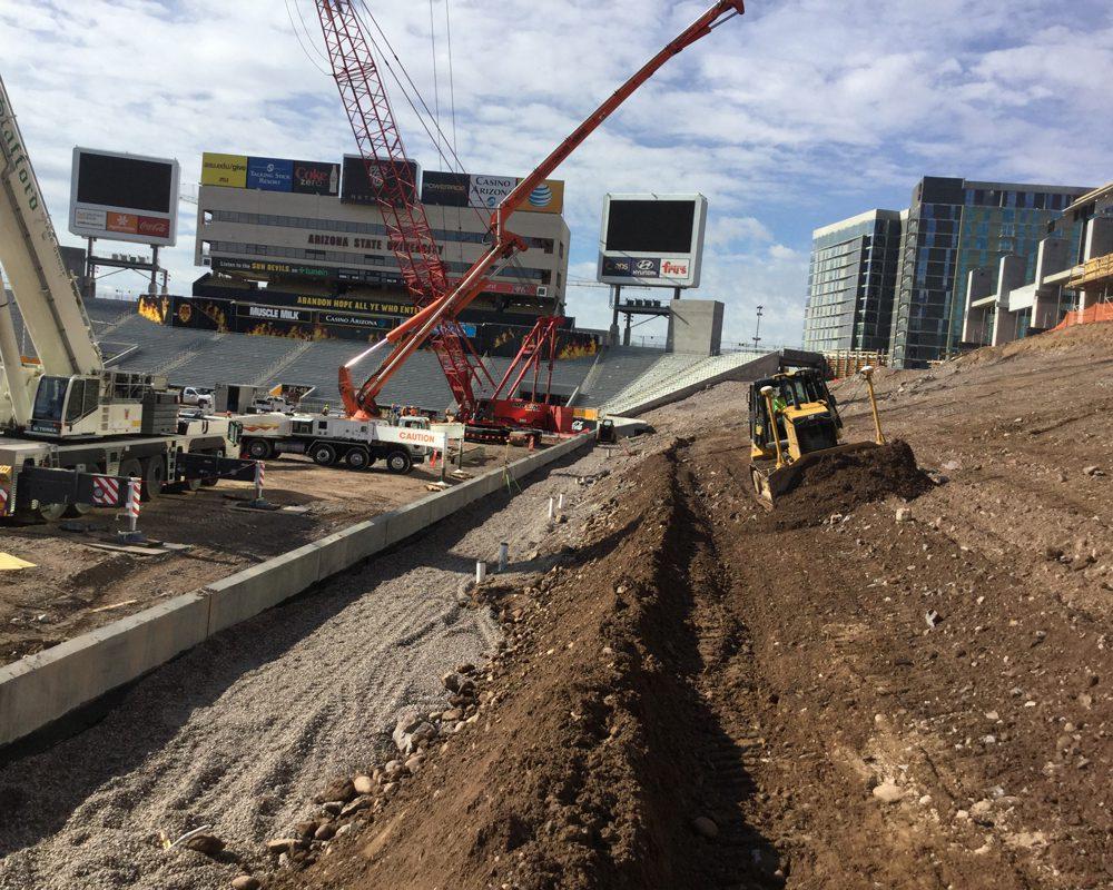 Excavator Moving Dirt at Sun Devil Stadium