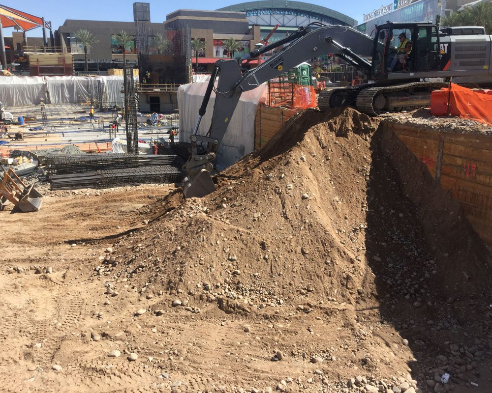 Blount Employee Leveling Dirt at Project Site
