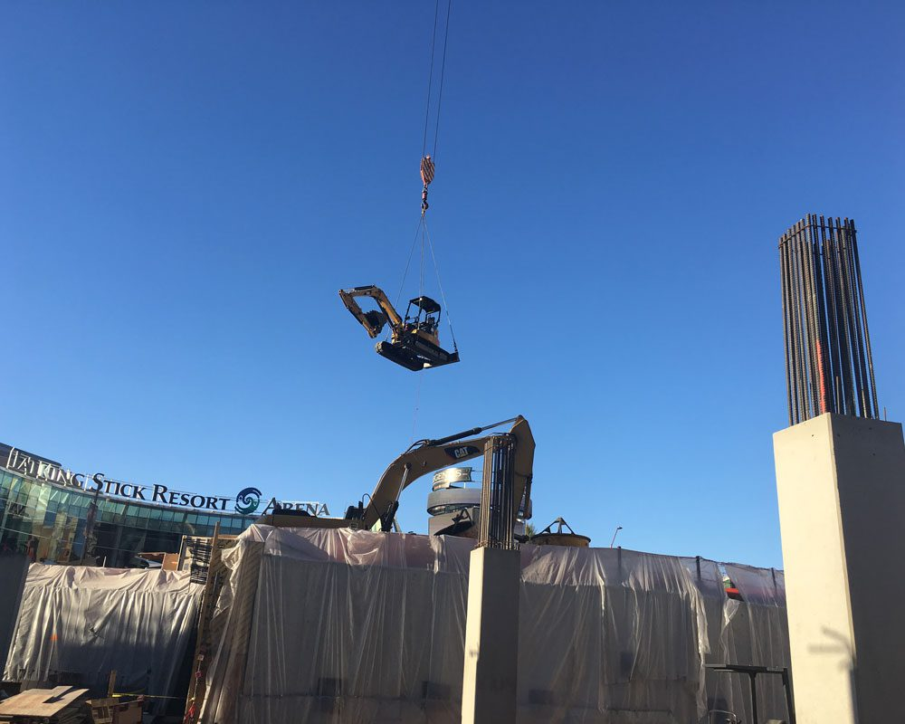 Excavator Transported by Heavy Crane at Project Site