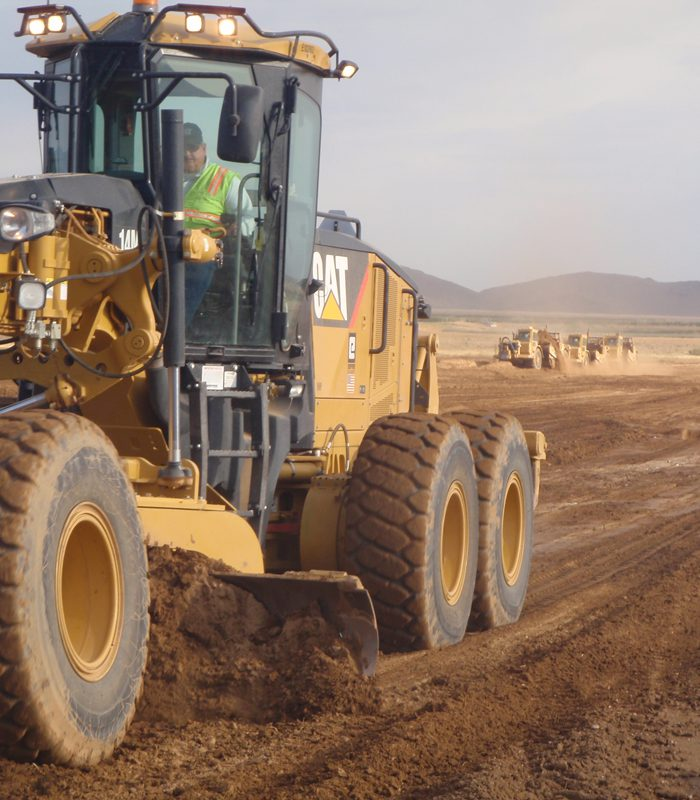 Blount Employee Operating CAT 14M Motor Grader at Project Site